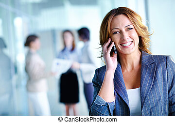 Working with smile - Office worker making a phone call...