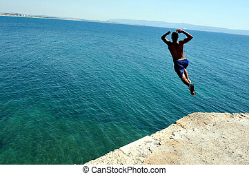 Travel Photos of Israel - Acer Akko - Arab boy jumps from...
