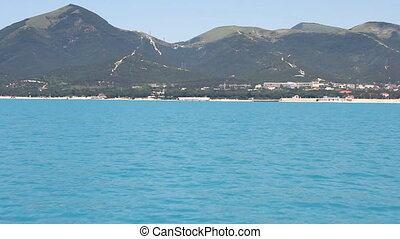 Summer panoramic view of the sea and mountain range