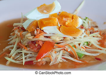 dish of papaya salad with salted eggs