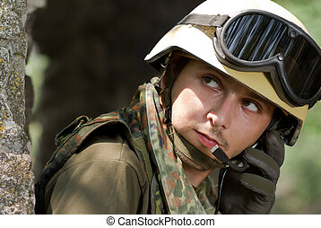 Soldier in helmet talking on a headset - Roget that, we're...