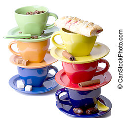 Colored cups with pastry, cinnamon sticks, coffee beans on a...