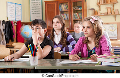 Schoolchildren at classroom during a lesson - Group of...