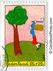 Woodcutter - NETHERLANDS - CIRCA 1987: stamp printed by...
