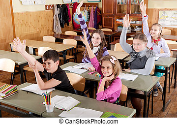 Schoolchildren raising hands - Group of schoolchildren at...