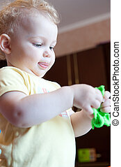 Little child modeling with clay - Cute baby girl modeling...