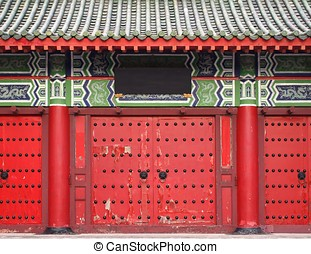 Traditional Chinese Red Temple Gate - A large gate leading...