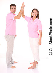 We did it - A picture of a young happy couple giving five...