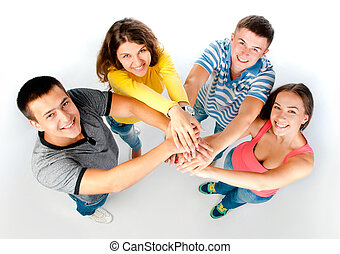 group of young people holding hands isolated on a white...