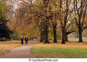 Park scene with joggers, Cologne, Germany