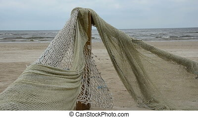 fishing nets on sea beach - landscape with fishing nets on...