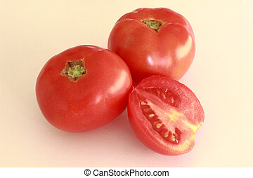 two red tomatoes and half