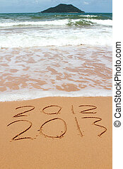 2013 year on the sand beach near the ocean 2012 is been...