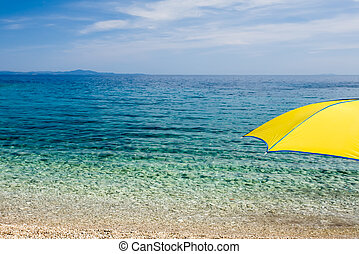 Yellow - A shocking yellow umbrella looking over the crystal...