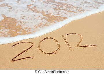 The welcome of the new year 2012; message in the sand at the...