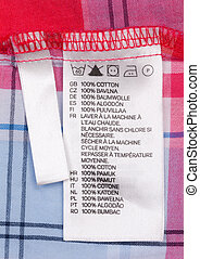 macro of clothing label - Close up view of a laundry advice...
