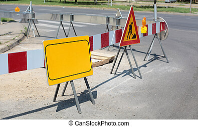 Roadworks - Road signs in a street under reconstruction