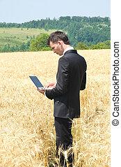 Business man on field
