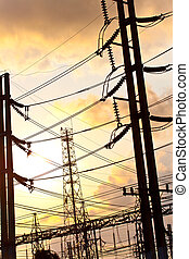 power technology - high voltage at sunset.