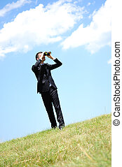 Business Man with spyglass - Business man with spyglass in...