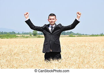 Business Man standing - Business man standing in wheat