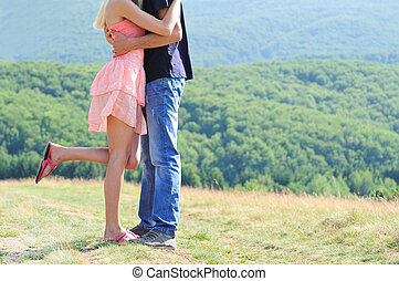 Young couple hugging in nature