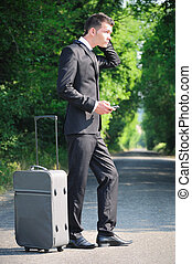 Business man on road - Business man with luggage on road