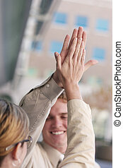 Business high-five - Business team dressed in tan clothes...