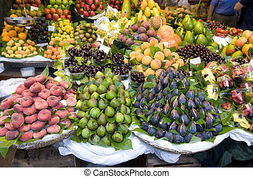 fresh fruit at the greengrocers including figs and peaches