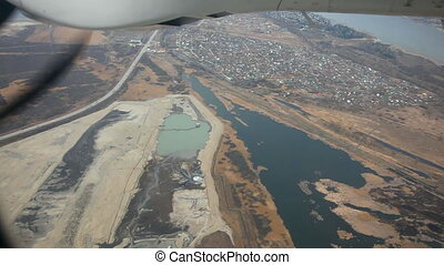 Landing. Plane gear. - Aerial view from reduced...