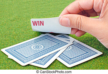 Play and win - Playing cards revealing the word win