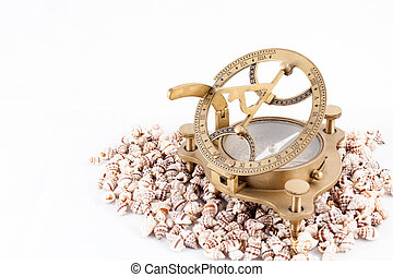 Old nautical sundial compass with shells isolated