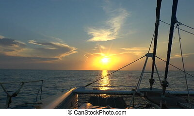 Catamaran, sailing to sunrise, Cuba