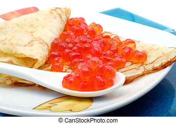 Pancake with red caviar - A pancake with a red caviar on...