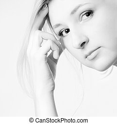 High Key Thinking - Young girl in a dress in the studio on a...