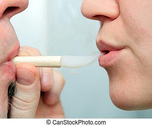 people enjoying smoking marijuana joint closeup