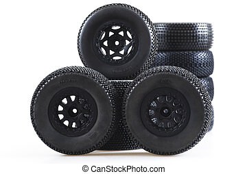 heap of wheels for radio-controlled models on a white background