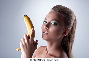 sexy girl take long banana like gun with desire