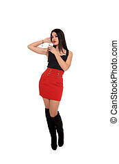 beautiful young girl with red skirt and black boots