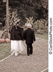 cute children together - two cute children walking together...