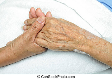 Comforting Hand - image of Woman Comforting Hand with her...