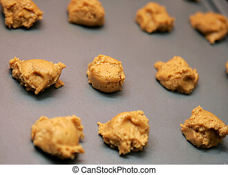 pb cookie dough - peanut butter cookie dough balls on a...