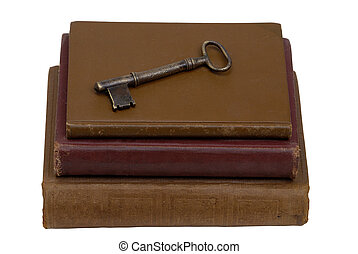 Key to Knowledge - Antique key on top of three old stacked...