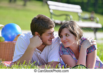 happy young couple having a picnic outdoor - happy young...