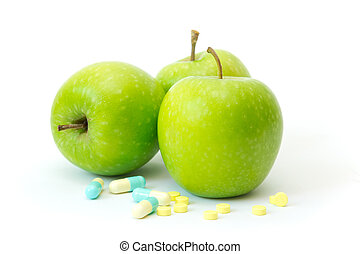 Green apple with slimming pills - Three green apples with...