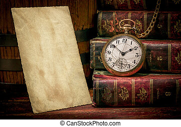 Old photo paper texture, pocket watch and books in Low-key -...
