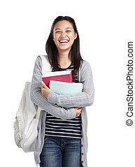 college student laughing - teenage girl with books and bag...