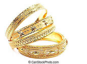 Woman jewelry - Three golden bracelets , on a white...