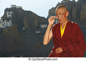 Indian tibetan monk - Indian tibetan old monk in red color...