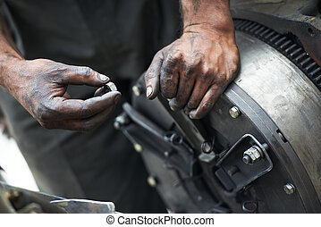 auto mechanic hands at car repair work - dirty car mechanic...